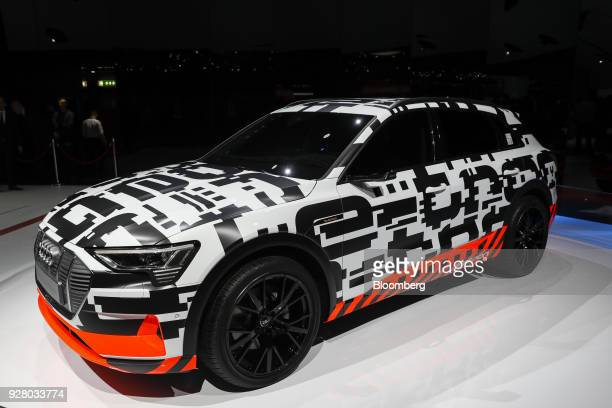 An Audi AG etron prototype electric automobile sits on the display on the opening day of the 88th Geneva International Motor Show in Geneva...