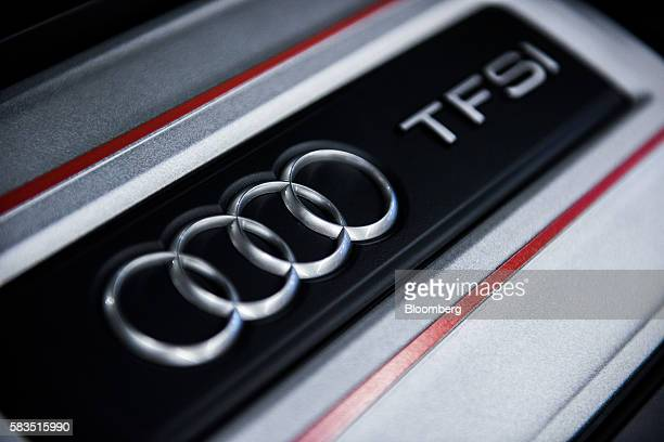An Audi logo badge sits on a TFSI engine inside the Audi AG production plant in Gyor Hungary on Monday July 25 2016 The European Commission is...