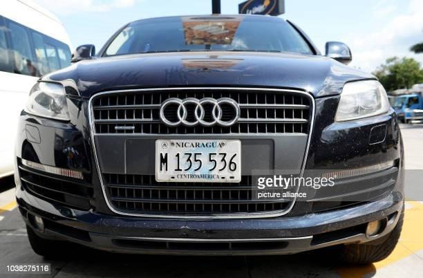 An Audi Q5 with a Nicaraguan vehicle registration plate on a parking spot in Managua Nicaragua 28 November 2015 PhotoJens Kalaene | usage worldwide