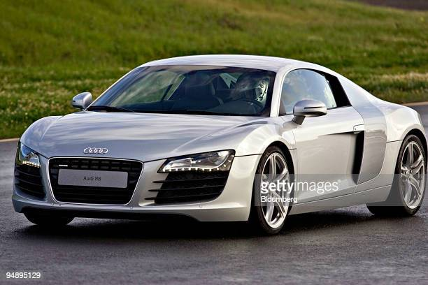 An Audi R8 sports car is driven at the Infineon Raceway in Sonoma California US on Wednesday Feb 20 2008 At the Audi Sportscar Experience the tool of...