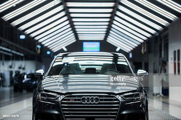 An Audi S3 stands waiting its final quality control check inside the Audi AG production plant in Gyor Hungary on Monday July 25 2016 The European...