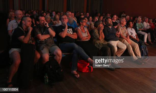 An audience listens to the band Siach HaSadeh perform during a concert at Yiddish Summer Weimar on July 28, 2018 in Weimar, Germany. The annual...