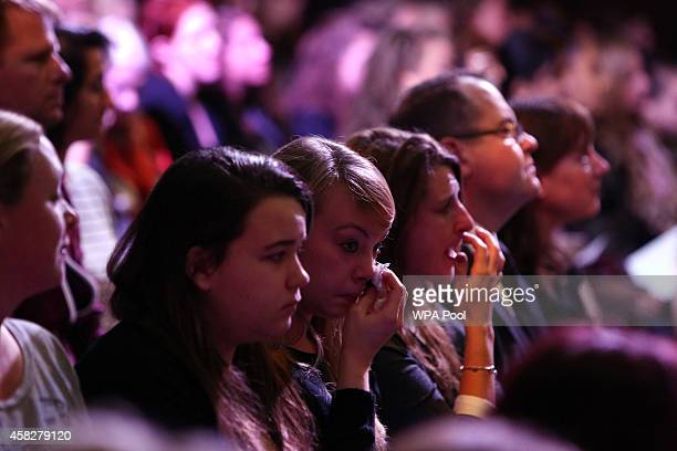 An audience looks on during a public memorial service in memory of murdered schoolgirl Alice Gross held at Greenford Town Hall on November 2 2014 in...
