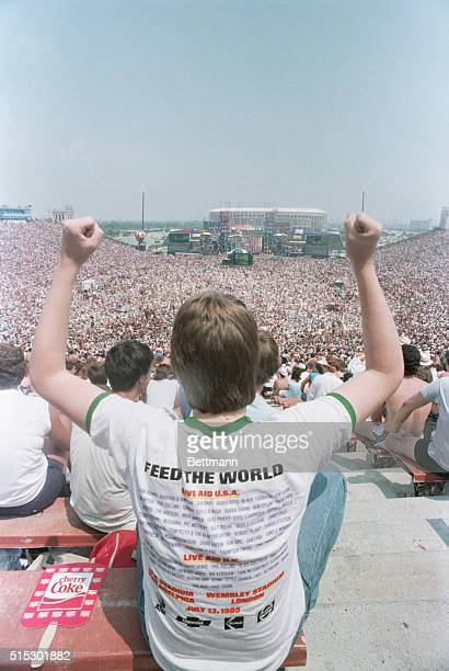 An audience member at the Live Aid concert in Philadelphia is shown wearing a Live Aid tshirt Performers at the event included Tina Turner the...