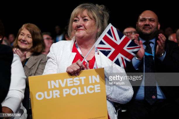 An audience member reacts to the keynote speech of Prime Minister Boris Johnson on the final day of the Conservative Party Conference at Manchester...