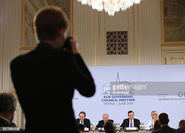 An audience member takes a photograph of left to right Vitor Constancio vice president of the European Central Bank Ewald Nowotny governor of...