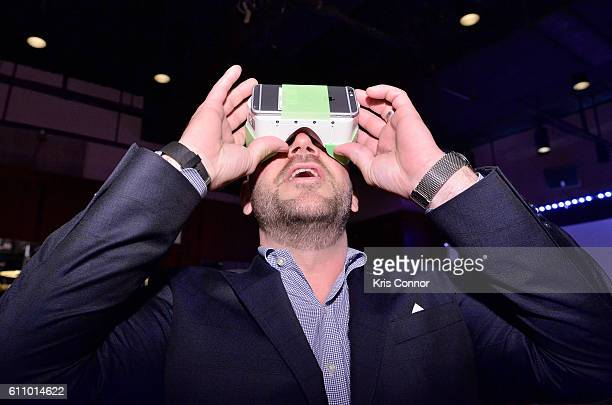 An audience member tries a VR headset at the The Future of Employee Engagement panel at Lucille's at BB King during 2016 Advertising Week New York on...