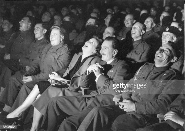 An audience, mostly servicemen, enjoying a comedy show at the BBC.