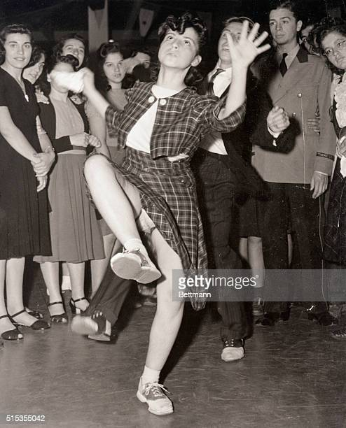 An audience surrounds a young woman dancing the jitterbug during a dance competition at the World's Fair