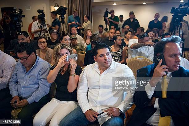 An audience waits for the arrival of Republican Presidential candidate and business mogul Donald Trump at a press conference during his trip to the...
