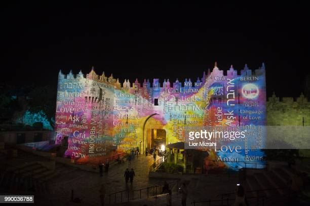 An audiovisual light show is projected over the walls of Damascus Gate out side the Old City during a light festival on July 2 2018 in Jerusalem...