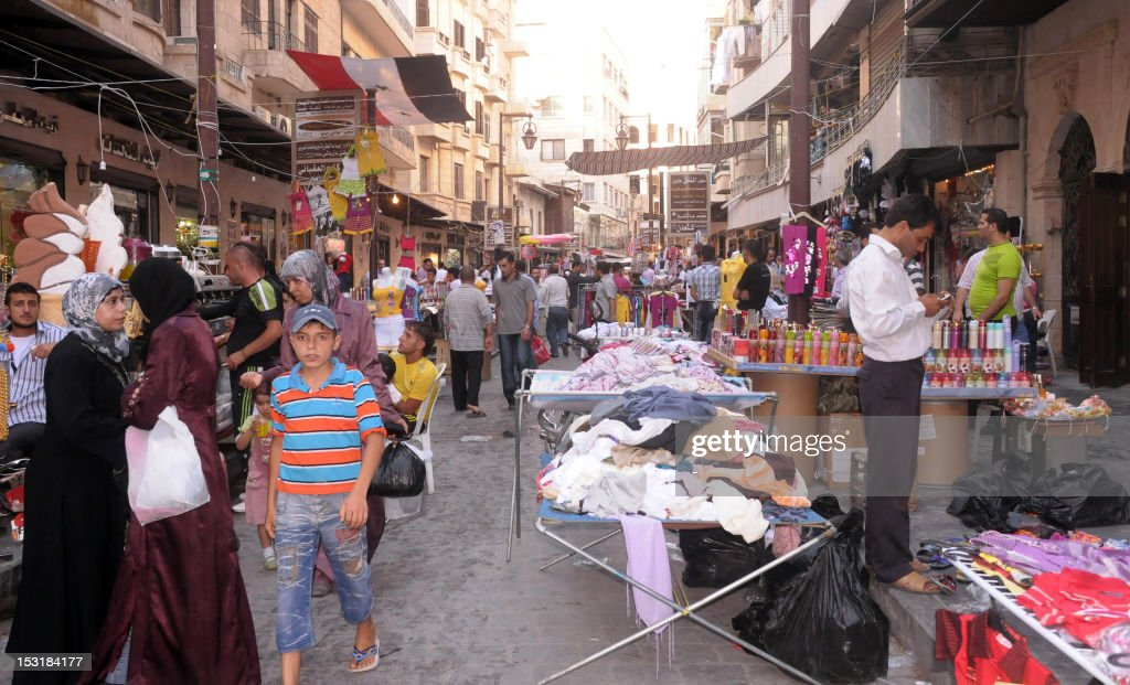 -An August 20, 2011, file photo shows traders, shops and stalls in the area of the medieval souk in the city of Aleppo in northern Syria. The ancient market, recognized by UNESCO as a world heritage site, was badly damaged by a blaze that started on September 28, 2012, destroying much of the souk as rebel forces clashed with Syrian government troops.
