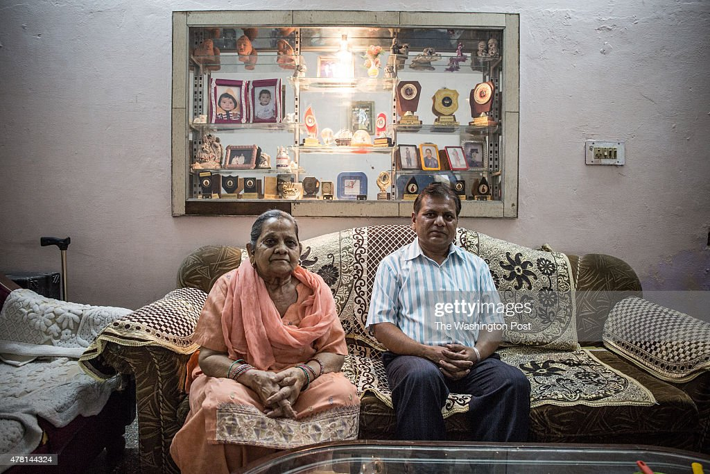 An aunt of Bobby Jindal Satya Bansal 72 years old and a cousin Sanjiv Jindal 48 years old pose for a portrait after an interview on June 17 2015 in...