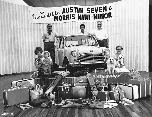 An Austin Seven Morris MiniMinor car on a podium with the amount of luggage it is reputed to hold
