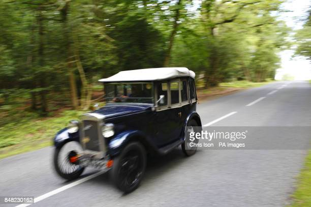 An Austin Seven Tourer 'Chummy' heads through the New Forest at the 50th Austin Seven Rally at the National Motor Museum in Beaulieu Hampshire