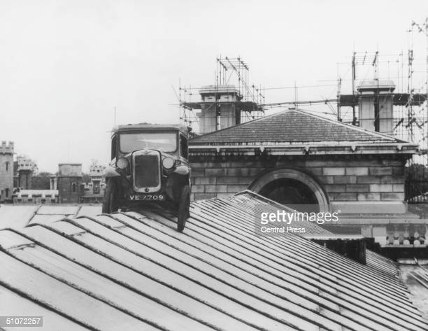 An Austin Seven van perched atop the Cambridge University Senate House 11th June 1958 The van was hoisted onto the roof as an undergraduate prank a...