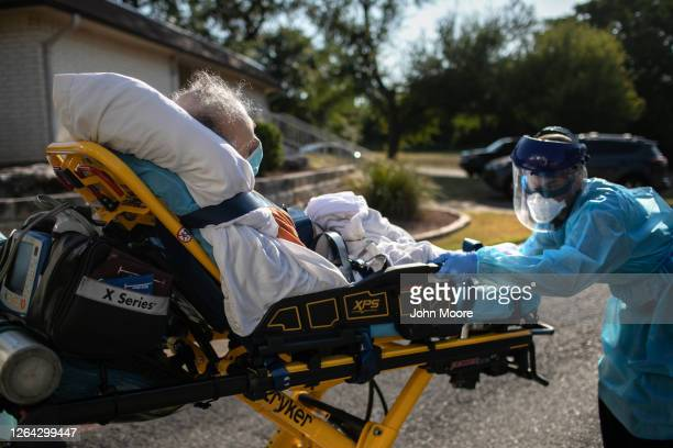 An AustinTravis County medic loads a patient with COVID19 symptoms into an ambulance on August 05 2020 in Austin Texas The medics where transporting...