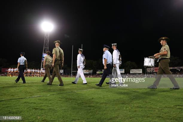 An Australia defense force catafalque party take the field during an ANZAC ceremony before the round seven NRL match between the Parramatta Eels and...