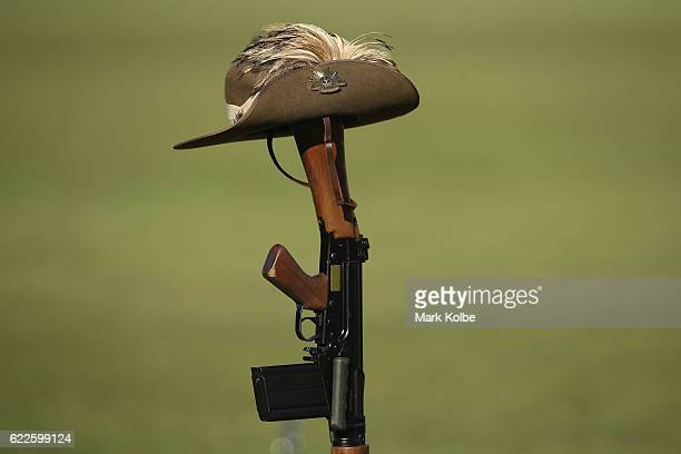 An Australia slouch hat is seen placed on an upturned rifle in the Remembrance Round prematch ceremony during the round six ALeague match between the...