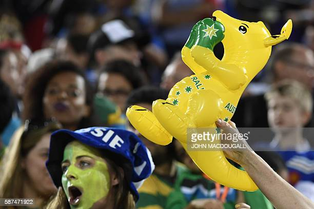 An Australia supporter holds a boxing kangaroo toy in the womens rugby sevens gold medal match between New Zealand and Australia during the Rio 2016...