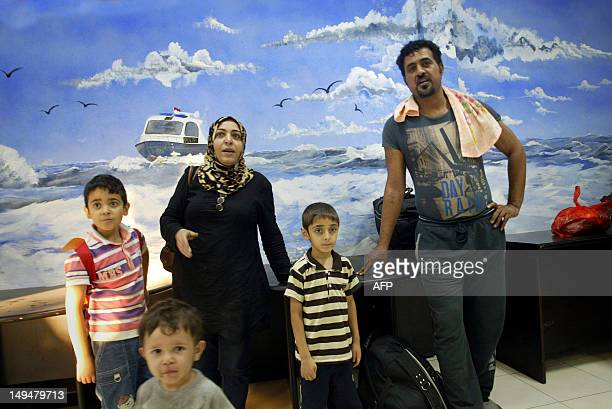 An Australiabound Iraqi family arrives at an Indonesian marine police station in Surabaya in East Java province on July 29 2012 after their stricken...