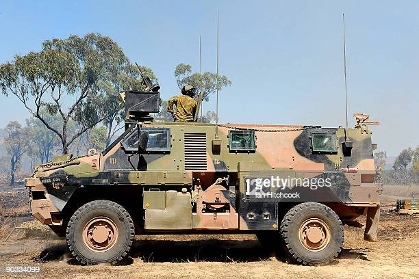 An Australian Army 'Bushmaster' amoured personal carrier is seen during an Army fire power demonstration at Range Control High Range on September 4...