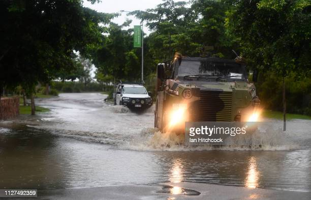 An Australian army Bushmaster vehicle crosses a flooded road in the suburb of Rosslea on February 05 2019 in Townsville Australia Townsville...