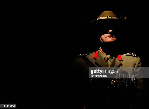 An Australian Army officer stands at attention during the dawn service on April 25 2013 in Townsville Australia Veterans dignitaries and members of...
