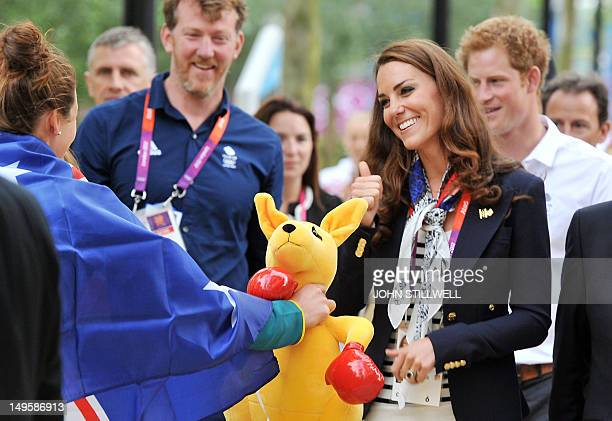An Australian athlete tries to present a toy Kangaroo to Catherine, the Duchess of Cambridge, which she declined but was then accepted by Prince...