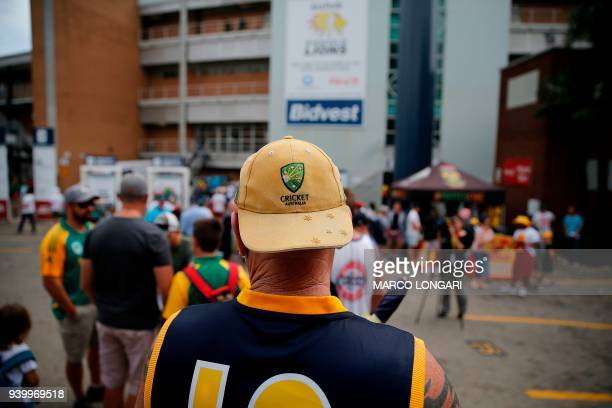 An Australian cricket supporter arrives to attend day one of the fourth cricket Test match between South Africa and Australia at Wanderers Stadium in...