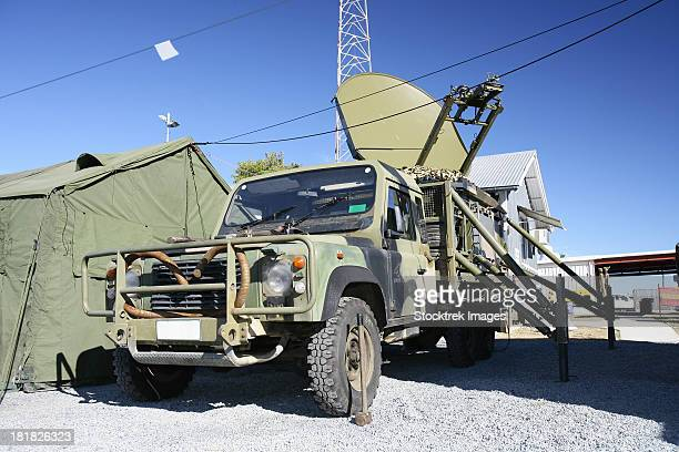 An Australian Defense Force Satellite Terminal Assembly is mounted on a 6x6 vehicle .
