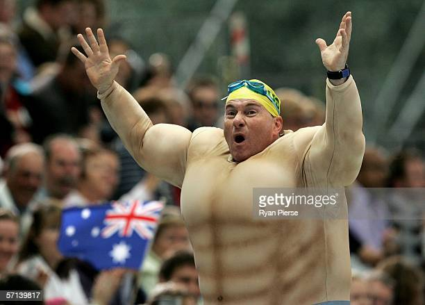 An Australian Fan gets the crowd going during the swimming at the Melbourne Sports Aquatic Centre during day six of the Melbourne 2006 Commonwealth...