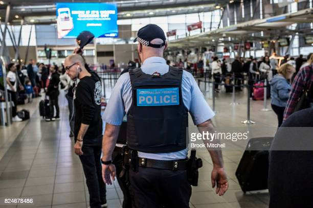 An Australian Federal Police officer on patrol at Sydney Domestic Airport on July 31 2017 in Sydney Australia Counter terrorism police raided four...