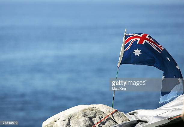 An Australian flag flies above the camp of Jhyimy Mhiyles known locally as the Bondi Caveman which overlooks the Tasman Sea and Australia's famous...