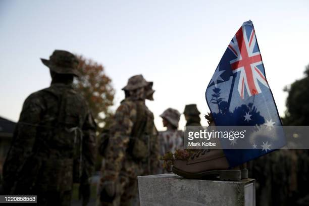 An Australian flag is seen in front of mannequins on display wearing various Australian soldier field uniforms from over a 100 year period are seen...