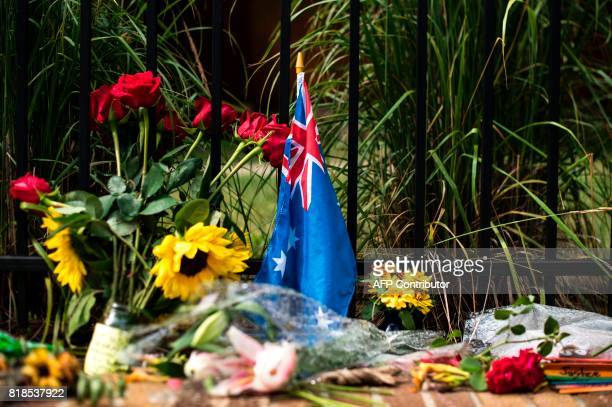 An Australian flag placed at a makeshift memorial for Justine Damond on July 18 2017 in Minneapolis Minnesota Scrutiny intensified into the death of...
