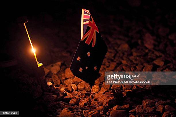 An Australian flag stands in memory during a ceremony to mark Anzac Day at Hellfire Pass in Karnchanaburi province in western Thailand on April 25...