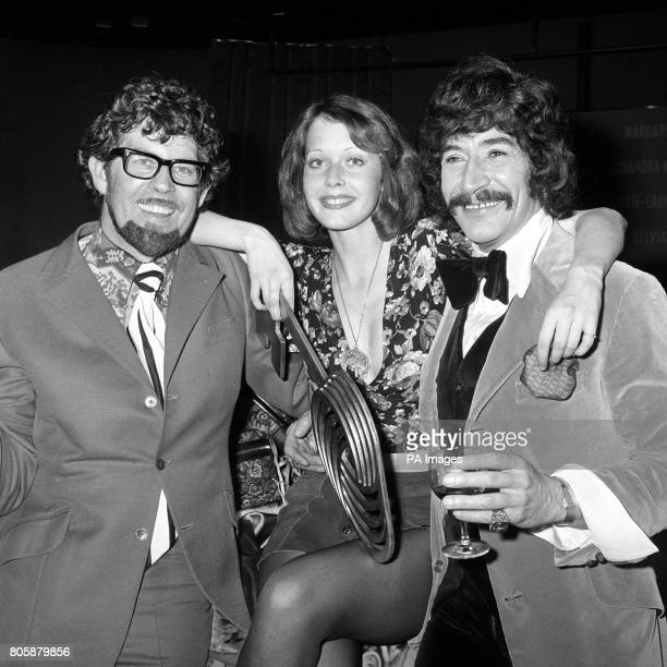 An Australian gets into the Common Market act Television entertainer Rolf Harris and actor Peter Wyngarde flank Miss TV Europe 1973 after her...