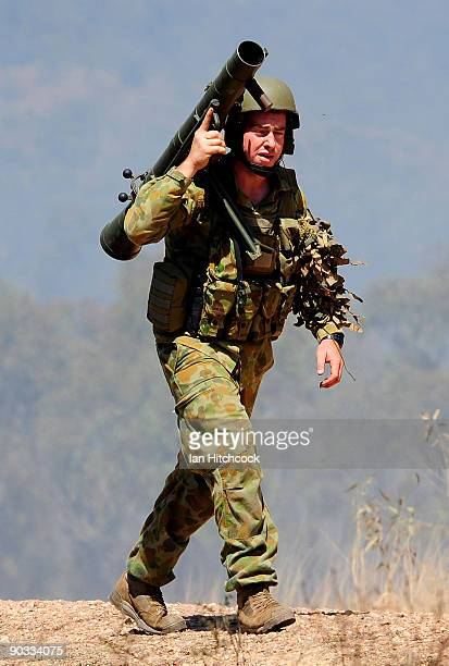 An Australian infantry soldier carries the 84mm 'Carl Gustav' portable antitank weapon during an Army fire power demonstration at Range Control High...