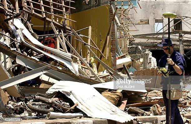 An Australian investigator collect data while using an 'ISITE' scanner in front of the destroyed Padi's bar in Kuta near Denpasar Bali 21 October...