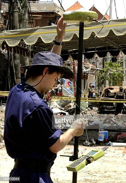 An Australian investigator collects data while using an 'ISITE' scanner in front of the destroyed Padi's bar in Kuta near Denpasar Bali 21 October...