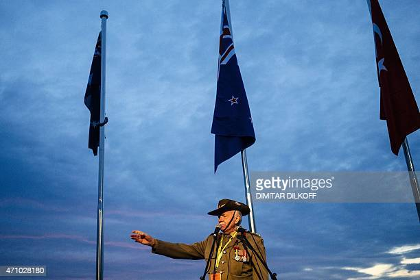 An Australian man speaks during an unofficial Dawn service marking the 100th anniversary of Anzac Day at Hamza koy beach in the town of Gallipoli on...