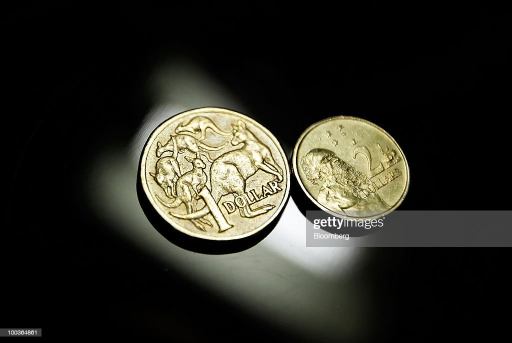 An Australian one-dollar coin and a two-dollar coin are arranged for a photograph, in Sydney, Australia, on Monday, May 24, 2010. The Australian and New Zealand currencies slid for the sixth time in seven days against the U.S. dollar on concern Europe's debt crisis will spread. Photographer: Ian Waldie/Bloomberg via Getty Images