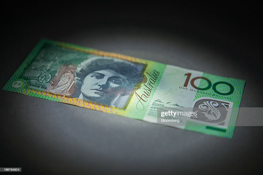 An Australian one-hundred dollar banknote is arranged for a photograph in Sydney, Australia, on Wednesday, April 17, 2013. Direct trading between the Australian dollar and yuan started on April 10. Photographer: Ian Waldie/Bloomberg via Getty Images