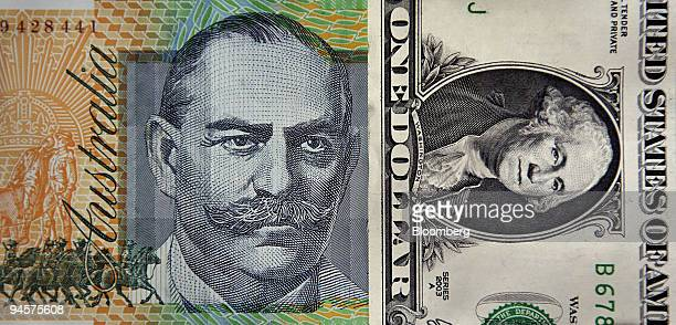 An Australian onehundreddollar note is displayed against an American onedollar bill in Sydney Australia on Tuesday July 24 2007 Anyone who likes the...