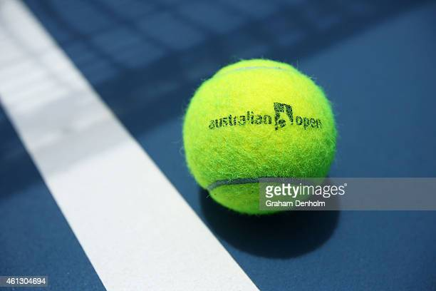 An Australian Open branded tennis ball is seen on court ahead of the 2015 Australian Open at Melbourne Park on January 11, 2015 in Melbourne,...