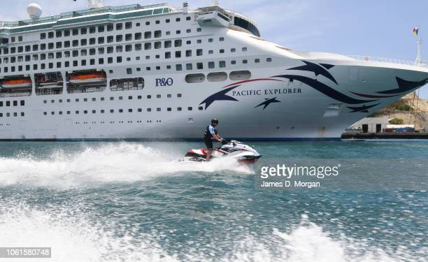 An Australian police officer rides a jetski past the PO Pacific Explorer venue for the start of the APEC CEO Summit on November 15 2018 in Port...