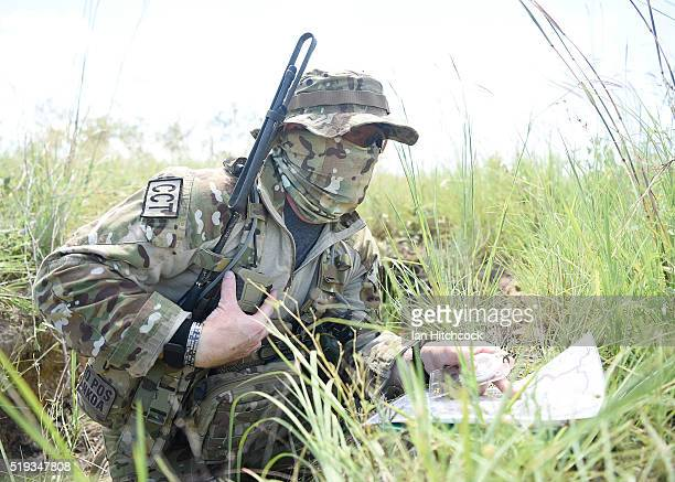 An Australian RAAF JTAC member checks his maps during air operations on April 6 2016 in Townsville Australia Exercise Black Dagger is a field...