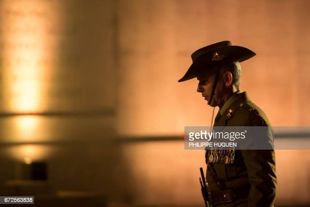 An Australian serviceman attends Anzac Day ceremonies at the military cemetery of the Australian National Memorial in VillersBretonneux northern...