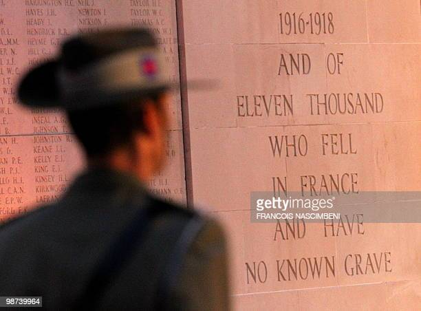 An Australian soldier attends a dawn service commemorating Anzac Day on the WWI battlefield of VillersBretonneux northern France on April 25 2010...